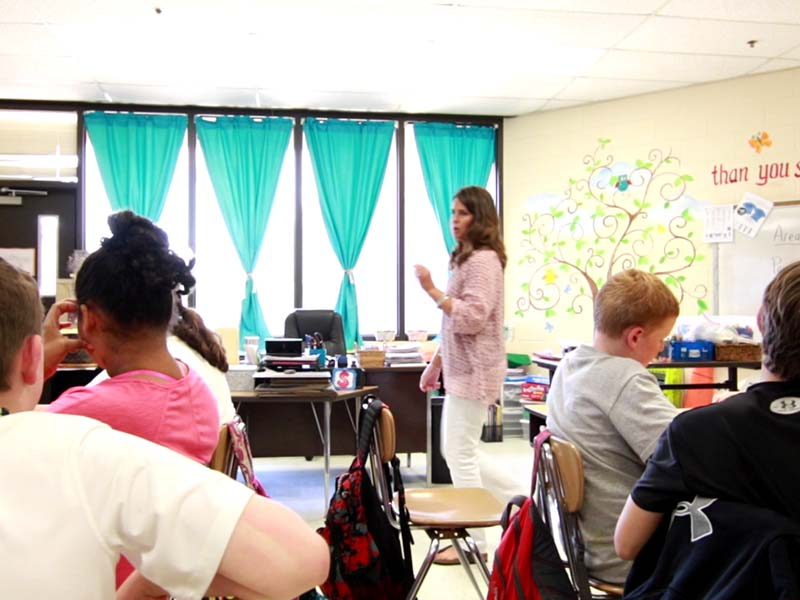 teacher teaching the students in the classroom